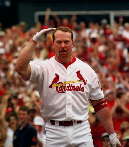 St. Louis Cardinals' Mark McGwire salutes in the direction of the family of the late Roger Maris after hitting his 61st home run of the season in the first inning off Chicago Cubs pitcher Mike Morgan, Monday, Sept. 7, 1998, in St. Louis. The home run tied Roger Maris' major league record of 61 set in 1961.
