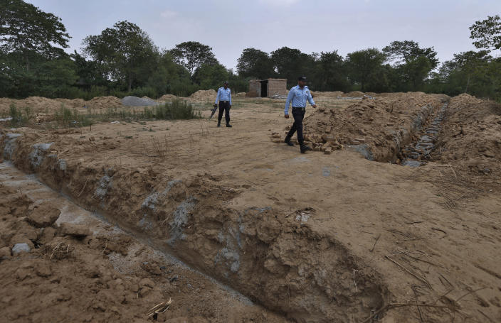 Police officers guard the site of a proposed Hindu temple after authorities stopped the construction, in Islamabad, Pakistan, Tuesday, July 7, 2020. Analysts and activists say minorities in Pakistan are increasingly vulnerable to Islamic extremists as Prime Minister Imran Khan vacillates between trying to forge a pluralistic nation and his conservative Islamic beliefs. (AP Photo/Anjum Naveed)