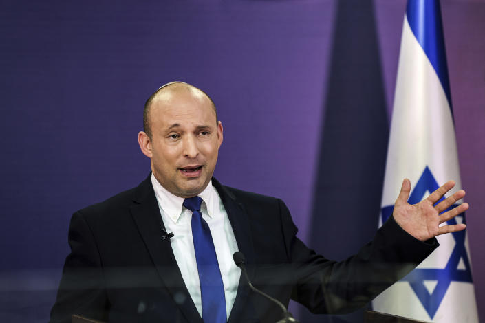 FILE - In this June 6, 2021, file photo, Naftali Bennett, Israeli parliament member from the Yamina party, gives a statement at the Knesset, Israel's parliament, in Jerusalem. If all goes according to plan, Israel will swear in a new government on Sunday, June 13, putting an end to Prime Minister Benjamin Netanyahu's record 12-year rule and a political crisis that led to four elections in less than two years. The next government, which will be led by the ultranationalist Bennett, has vowed to chart a new course aimed at healing the country's divisions and restoring a sense of normalcy. (Menahem Kahana/Pool via AP, File)