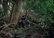 Paranormal investigator Charles Goh looks for signs of former settlements in a jungle in Singapore
