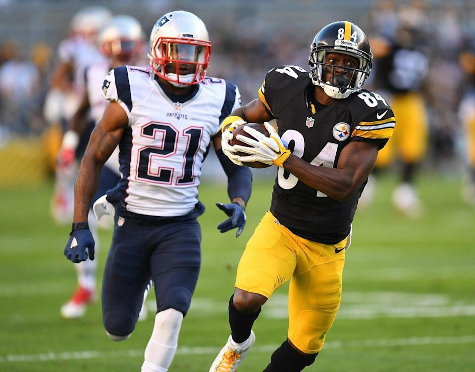Antonio Brown of the Pittsburgh Steelers is pursued by Malcolm Butler of the New England Patriots after making a catch. (Photo by Joe Sargent/Getty Images)