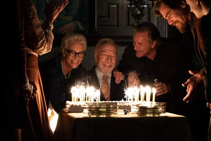 Christopher Plummer faces a giant birthday cake full of lit candles in 'Knives Out.'
