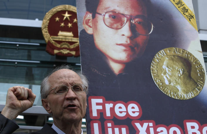 FILE - In this Monday, Oct. 11, 2010 file photo, a pro-democracy protester holding a poster of Chinese dissident and Nobel Peace Prize winner Liu Xiaobo, demands his release outside China's Liaison Office in Hong Kong. Mainly associated with conflict resolution, foreign assistance and cozy Scandinavian prosperity, Norway makes an odd target for China's ire. Yet for three years, Beijing has frozen relations with Oslo since a committee appointed by the Norwegian parliament awarded the 2010 Nobel Peace Prize to imprisoned Chinese dissident Liu Xiaobo, deeply embarrassing China's leaders. (AP Photo/Kin Cheung, File)