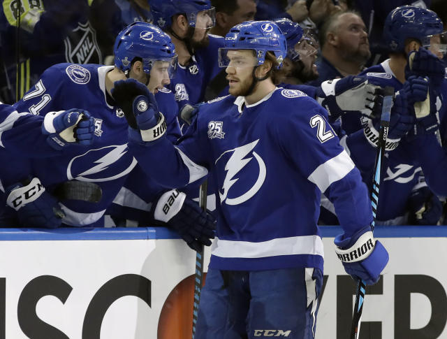 Tampa Bay Lightning center Brayden Point (21) celebrates with the bench after scoring against the Washington Capitals during the first period of Game 2 of the NHL Eastern Conference finals hockey playoff series Sunday, May 13, 2018, in Tampa, Fla. (AP Photo/Chris O'Meara)