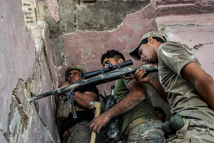 <p>An Iraqi Special Operation Forces (ISOF) sniper team in the Islamic State occupied Old City district where heavy fighting continues on July 8, 2017 in Mosul, Iraq. (Photo: Martyn Aim/Corbis via Getty Images) </p>