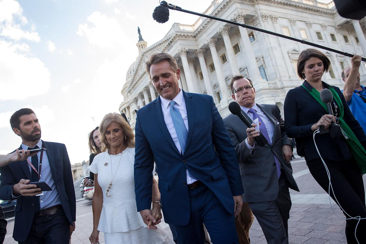 Sen. Jeff Flake (R-Ariz) and his wife Cheryl Flake leave the U.S. Capitol after he announced he will not be seeking reelection. (Photo: Drew Angerer via Getty Images)