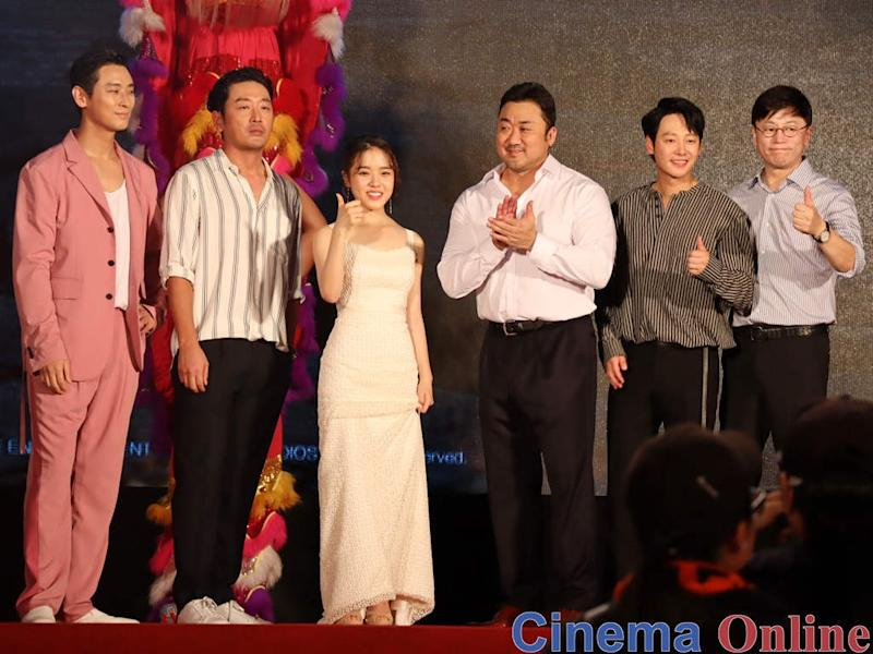 "The cast and director of ""Along with the Gods 2: The Last 49 Days"" at the red carpet event in Taipei."