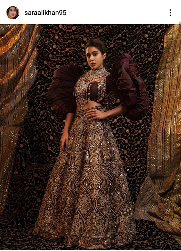 The Abu Jani-Sandeep Khosla ensemble was a breath-taking amalgam of powerful and pretty on the <em>Love Aaj Kal </em>actress. The burgundy and golden <em>lehenga </em>paired was paired with a solid blouse featuring dramatic sculptural puff-sleeves complete with a heavy jadau collar made for an utterly glamorous opening for the ace designer duo's show at the Blenders Pride Fashion Tour.