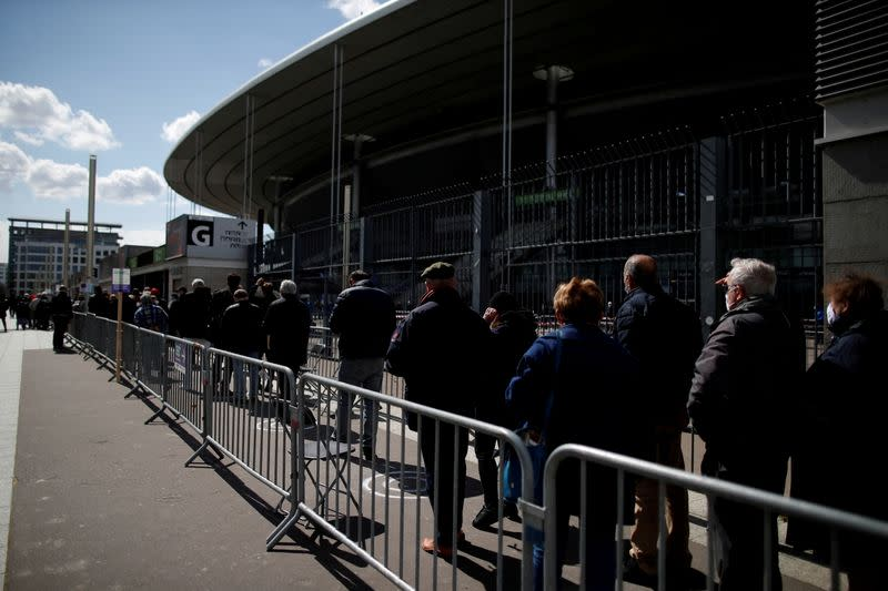 FILE PHOTO: Vaccinations begin at the Stade de France stadium opened as a mass vaccination center