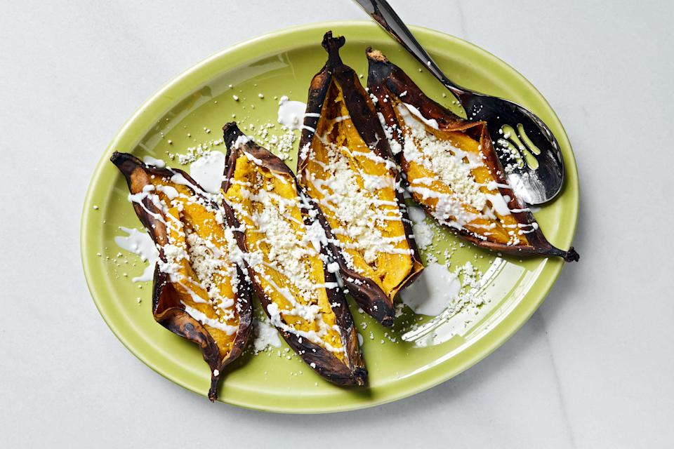 """Put these on the grill while you eat dinner, and they'll be ready when it's time for dessert. <a href=""""https://www.epicurious.com/recipes/food/views/platanos-horneados-con-crema-y-queso-baked-banana?mbid=synd_yahoo_rss"""" rel=""""nofollow noopener"""" target=""""_blank"""" data-ylk=""""slk:See recipe."""" class=""""link rapid-noclick-resp"""">See recipe.</a>"""