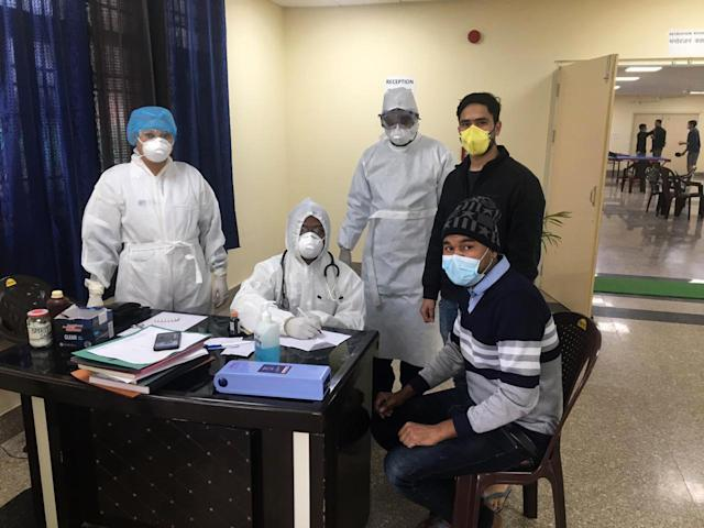 In this handout photo provided by the Indo-Tibetan Border Police (ITBP) shows Indian nationals who were airlifted from coronavirus-hit Hubei province of Chinas Wuhan, undergo tests inside a quarantine facility set by up ITBP, at Chhawla area of New Delhi.