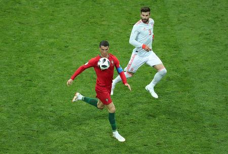 Soccer Football - World Cup - Group B - Portugal vs Spain - Fisht Stadium, Sochi, Russia - June 15, 2018 Portugal's Cristiano Ronaldo in action with Spain's Gerard Pique REUTERS/Lucy Nicholson