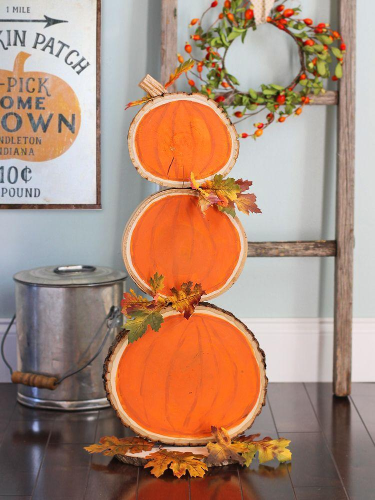 "<p>Make the hard work of your DIY project last through the seasons with this reversible fall and winter wood slice decoration. It can be displayed as a pumpkin stack in November and switched to a snowman once December hits. <a href=""https://www.thecraftpatchblog.com/reversible-fall-and-christmas-wood/"" rel=""nofollow noopener"" target=""_blank"" data-ylk=""slk:The Craft Patch"" class=""link rapid-noclick-resp"">The Craft Patch</a> blog used a drill to ensure the pieces stay together.</p><p><a class=""link rapid-noclick-resp"" href=""https://go.redirectingat.com?id=74968X1596630&url=https%3A%2F%2Fwww.michaels.com%2Fpaint-brushes-by-creatology%2F10419191.html&sref=https%3A%2F%2Fwww.delish.com%2Fholiday-recipes%2Fthanksgiving%2Fg33808794%2Fthanksgiving-decorations%2F"" rel=""nofollow noopener"" target=""_blank"" data-ylk=""slk:BUY NOW"">BUY NOW</a> <strong><em>Paint brushes, $6.79</em></strong></p>"