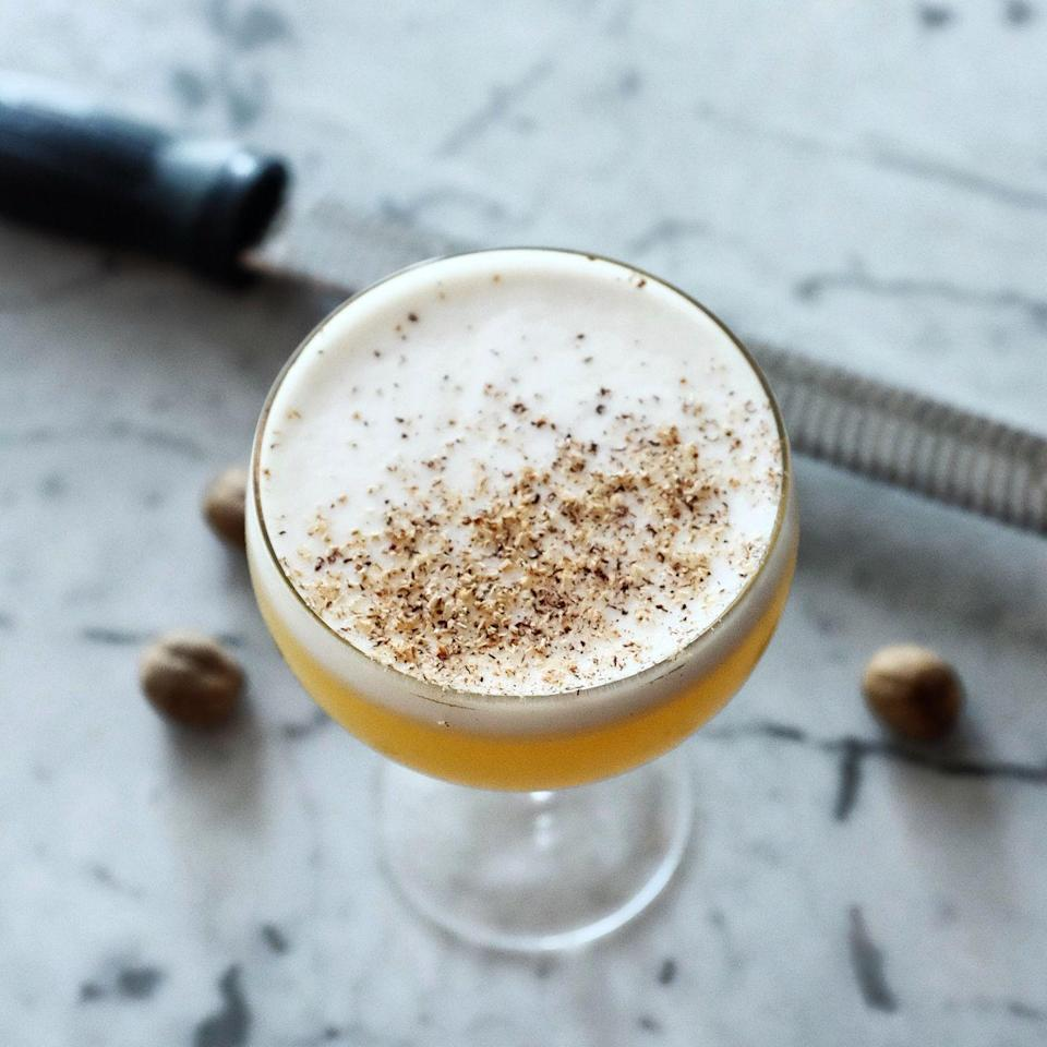 """<p><strong>Ingredients</strong><br></p><p>1.75 oz Carriage House Apple Brandy<br>1 oz apple cider<br>1 oz fresh lemon juice<br>.75 oz egg whites<br>.5 oz honey<br>1 whole nutmeg</p><p><strong>Instructions</strong></p><p>Combine apple brandy, fresh lemon juice, egg whites, honey and apple cider in a shaker tin. Shake vigorously for 20 seconds to froth the egg whites. Add ice and shake vigorously for another 20 seconds. Double-strain into a coupe glass. Make sure you have at least a quarter inch of froth on top. Microplane fresh nutmeg on half of foam.</p><p><em>From <a href=""""http://kindreddavidson.com/"""" rel=""""nofollow noopener"""" target=""""_blank"""" data-ylk=""""slk:Kindred Restaurant"""" class=""""link rapid-noclick-resp"""">Kindred Restaurant</a> in Davidson, North Carolina</em><br></p>"""