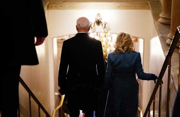US President Joe Biden (L) and US First Lady Jill Biden walk through the Crypt of the US Capitol for the inauguration ceremony making Biden the 46th President of the United States in Washington DC on January 20, 2021. (Photo by JIM LO SCALZO / POOL / AFP) (Photo by JIM LO SCALZO/POOL/AFP via Getty Images)