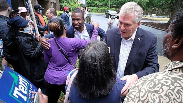 PHOTO: Former Virginia Gov. Terry McAuliffe, right, and Richmond Mayor Levar Stoney, left, greet McAuliffe supporters during a quick rally outside the Office of the General Registrar, in Richmond, Virginia, on  Friday, June 4, 2021. (Bob Brown/AP)
