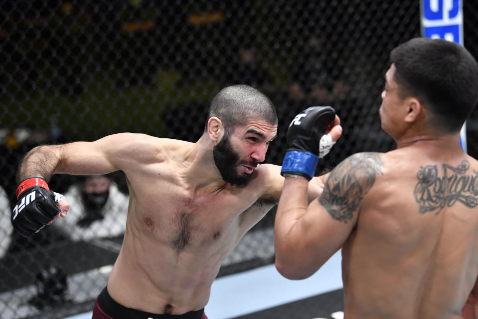 LAS VEGAS, NEVADA - FEBRUARY 20: In this UFC handout, (L-R) Aiemann Zahabi of Canada punches Drako Rodriguez in a bantamweight bout during the UFC Fight Night event at UFC APEX on February 20, 2021 in Las Vegas, Nevada. (Photo by Chris Unger/Zuffa LLC)