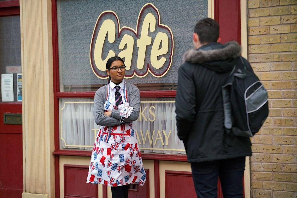 <p>Roy has given her a trial shift at the café. </p>