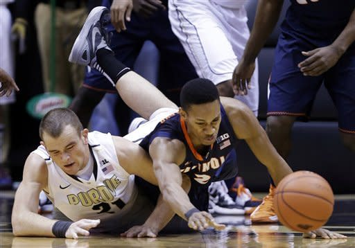Illinois guard Joseph Bertrand, right, and Purdue forward D.J. Byrd dive for a loose ball in the first half of an NCAA college basketball game in West Lafayette, Ind., Wednesday, Jan. 2, 2013. (AP Photo/Michael Conroy)