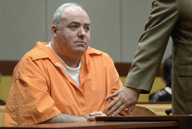 Michael Skakel, left, is hushed by his attorney Hubert Santos, right, after speaking out of turn in court in Middletown, Conn., Tuesday, Jan. 24, 2012.  Skakel is seeking a reduction in his sentence of 20 years to life in prison for killing his neighbor Martha Moxley. (AP Photo/Jessica Hill, Pool)