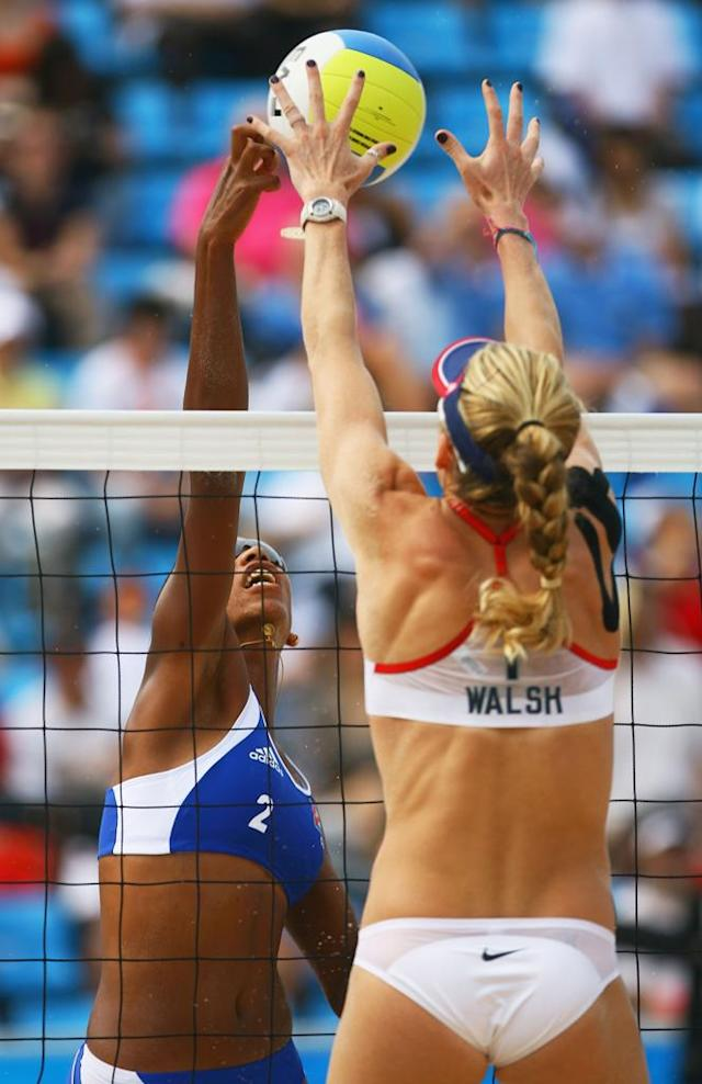 Tamara Larrea of Cuba has her shot blocked by Kerri Walsh of the USA in the Women's Preliminary Pool B match held at the Chaoyang Park Beach Volleyball Ground on Day 4 of the Beijing 2008 Olympic Games on August 12, 2008 in Beijing, China.
