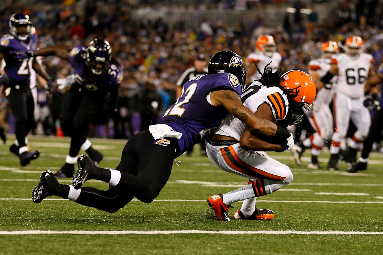 BALTIMORE, MD - SEPTEMBER 27:  Defensive back Jimmy Smith #22 of the Baltimore Ravens tackles wide receiver Travis Benjamin #80 of the Cleveland Browns just shy of the end zone during the NFL Game at M&T Bank Stadium on September 27, 2012 in Baltimore, Maryland.  (Photo by Rob Carr/Getty Images)