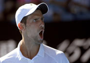 Serbia's Novak Djokovic reacts after winning the second set against Canada's Denis Shapovalov during their third round match at the Australian Open tennis championships in Melbourne, Australia, Saturday, Jan. 19, 2019. (AP Photo/Andy Brownbill)
