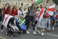 Women with old Belarusian national flags and their kids march during an opposition rally to protest the official presidential election results in Minsk, Belarus, Saturday, Sept. 5, 2020. Women's marches and demonstrations have become a regular feature of the four weeks of protest that have shaken Belarus following a disputed election that gave Belarusian President Alexander Lukashenko a sixth term in office. (AP Photo)
