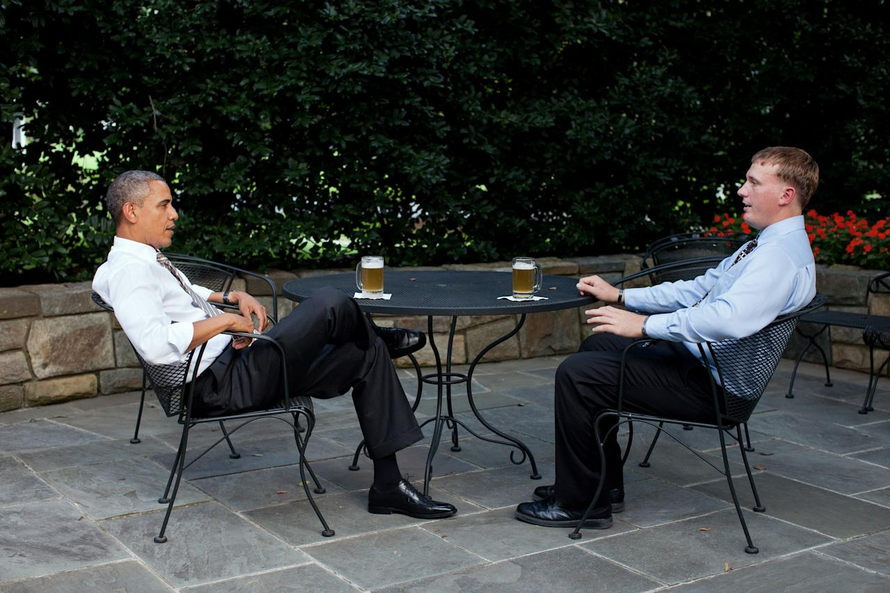 WASHINGTON - SEPTEMBER 14: In this handout provided by the White House, U.S. President Barack Obama (L) enjoys a beer with Dakota Meyer on the patio outside of the Oval Office September 14, 2011 in Washington, DC. Obama will present Meyer with the Medal of Honor on September 15 during a ceremony at the White House. (Photo by Pete Souza/The White House via Getty Images)
