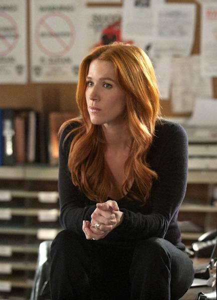 """In this publicity image released by CBS, Poppy Montgomery is shown in a scene from """"Unforgettable."""" (AP Photo/CBS, Barbara Nitke) """""""