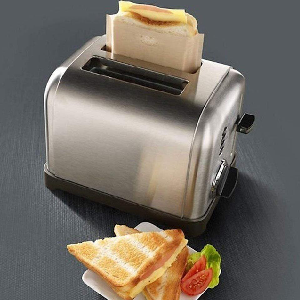 """Sowhen your next craving for a midnight grilled cheese hits, you can simply pop it in the toaster, no pans needed.<br /><br /><strong>Promising review:</strong>""""I bought this for my elderly mom who loves grilled cheese sandwiches. I was skeptical that this bag on the toaster would work but it did! The only thing I would suggest is after you toast the sandwich, let it sit for a few minutes so the cheese melts better. I prepared it and gave it to her straight away. Bread was toasted on the outside. Clean up was easy. All in all impressive!"""" — <a href=""""https://www.amazon.com/gp/customer-reviews/RJOSPLIHL2VCI?&linkCode=ll2&tag=huffpost-bfsyndication-20&linkId=c93878989ff07e0a31f1105aea6f77e8&language=en_US&ref_=as_li_ss_tl"""" target=""""_blank"""" rel=""""noopener noreferrer"""">Christopher Carnrick at Pirate Palms</a><br /><br /><strong><a href=""""https://www.amazon.com/Reusable-Resistant-Sandwiches-Pastries-Vegetables/dp/B071D9T6Z9?&linkCode=ll1&tag=huffpost-bfsyndication-20&linkId=63e425a96affaabd9eef7d33e764f255&language=en_US&ref_=as_li_ss_tl"""" target=""""_blank"""" rel=""""noopener noreferrer"""">Get a pack of four from Amazon for $7.99.</a></strong>"""