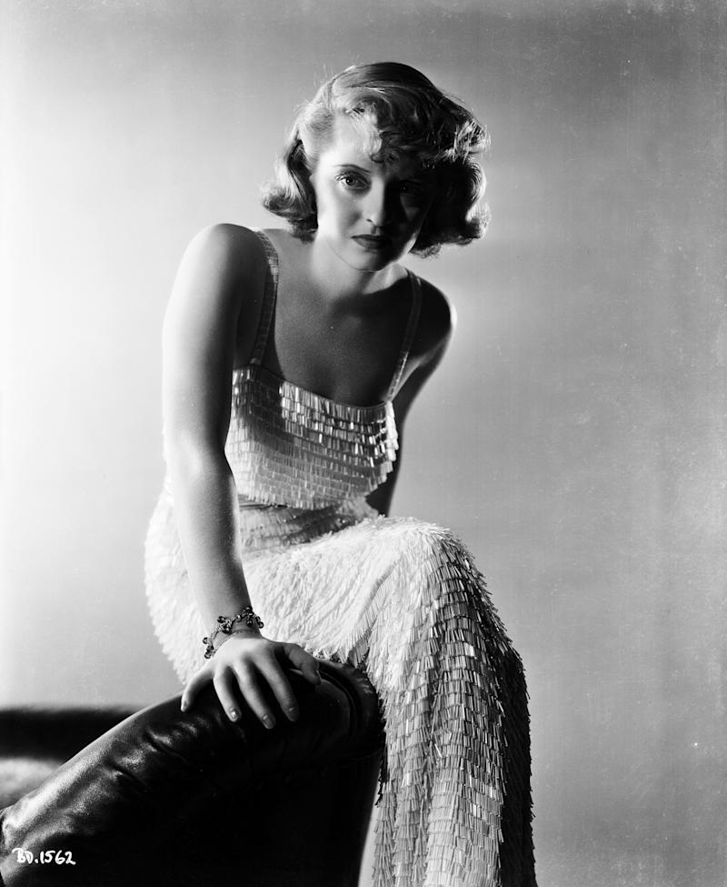 Davis wears a dress with sequins in a photo from 1937.