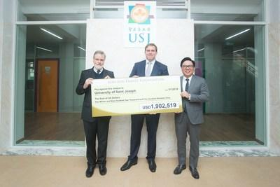 Las Vegas Sands and Sands China executives present a US$1.9 million (approximately MOP 15.4 million) cheque to the University of Saint Joseph on behalf of the Adelson Family Foundation Tuesday at the university. Left to right: Fr. Peter Stilwell, rector, University of Saint Joseph; Patrick Dumont, executive vice president and chief financial officer, Las Vegas Sands Corp.; Dr. Wilfred Wong, president, Sands China Ltd.