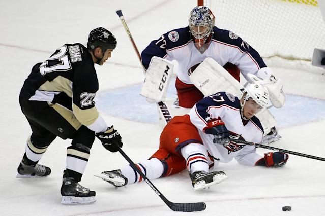 Pittsburgh Penguins' Craig Adams (27) can't get to a loose puck in front of Columbus Blue Jackets' Ryan Murray (27) and goalie Sergei Bobrovsky (72) during the third period of a first-round NHL playoff hockey game in Pittsburgh on Wednesday, April 16, 2014. The Penguins won 4-3. (AP Photo/Gene J. Puskar)