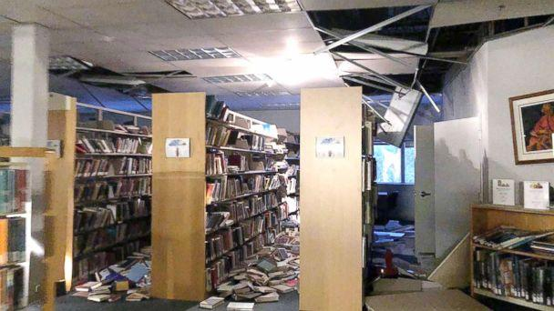 PHOTO: In this courtesy image books and ceiling tiles litter the floor at the The Mat-Su College library in Anchorage, Ala., Nov. 30, 2018. (Handout/Dr. Holly A. Bell/AFP/Getty Images)