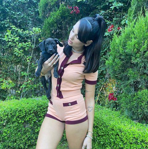 """<p>Lipa wore a Chanel two-piece to pose with her pup Dexter.</p><p><a href=""""https://www.instagram.com/p/CDrAORzMjEl/"""" rel=""""nofollow noopener"""" target=""""_blank"""" data-ylk=""""slk:See the original post on Instagram"""" class=""""link rapid-noclick-resp"""">See the original post on Instagram</a></p>"""