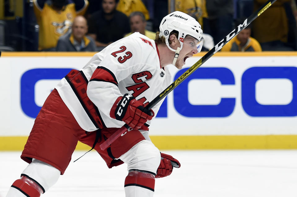 Carolina Hurricanes left wing Brock McGinn (23) celebrates after scoring a goal against the Nashville Predators during the first period in Game 6 of an NHL hockey Stanley Cup first-round playoff series Thursday, May 27, 2021, in Nashville, Tenn. (AP Photo/Mark Zaleski)