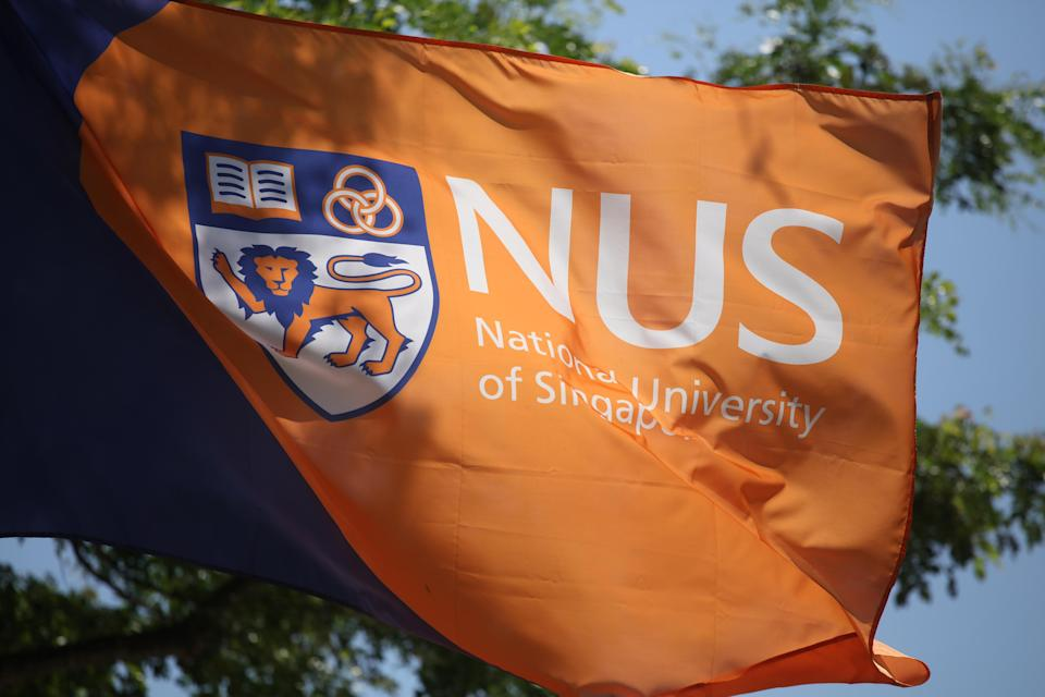 Logo and crest of NUS seen on a flag. (Yahoo News Singapore file photo)