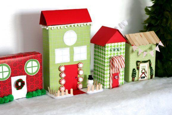 """<p>You don't need to buy a fancy Christmas village at the store. You can make one with your old cereal and granola-bar boxes, decorated with wrapping paper and candy.</p><p><em><a href=""""https://pagingsupermom.com/recycled-christmas-village/"""" rel=""""nofollow noopener"""" target=""""_blank"""" data-ylk=""""slk:Get the tutorial at Paging Supermom »"""" class=""""link rapid-noclick-resp"""">Get the tutorial at Paging Supermom »</a></em></p>"""