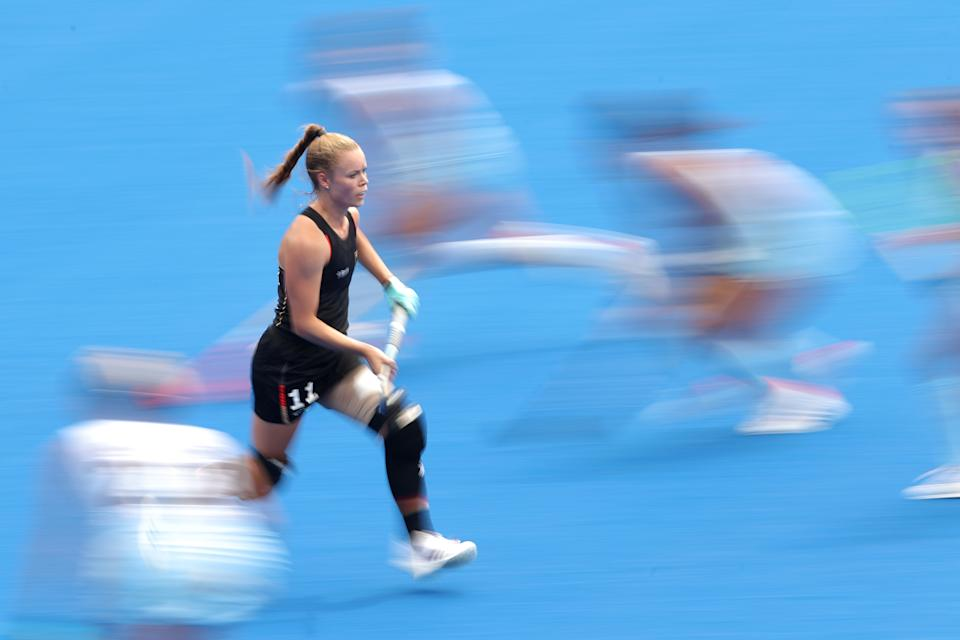 <p>Lena Micheel of Team Germany runs upfield during the Women's Quarterfinal match between Germany and Argentina on day ten of the Tokyo 2020 Olympic Games at Oi Hockey Stadium on August 02, 2021 in Tokyo, Japan. (Photo by Alexander Hassenstein/Getty Images)</p>