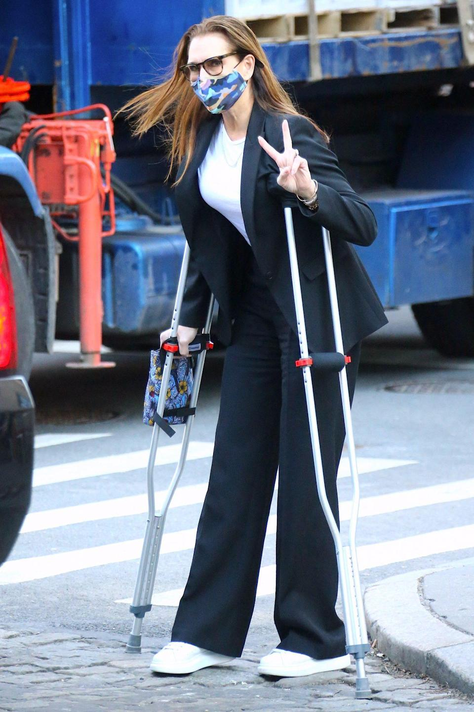 "<p>Brooke Shields arrives at Café Cluny on crutches, after <a href=""https://people.com/style/brooke-shields-talks-recovery-after-breaking-femur/"" rel=""nofollow noopener"" target=""_blank"" data-ylk=""slk:breaking her femur last month,"" class=""link rapid-noclick-resp"">breaking her femur last month,</a> on Tuesday in N.Y.C.'s West Village.</p>"