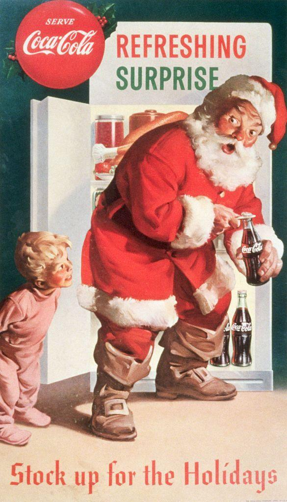 "<p>Coca-Cola is at it again. This time, a child catches a Christmas surprise when he finds Santa sneaking a refreshing beverage out of the fridge. The popular soda company <a href=""https://www.theguardian.com/lifeandstyle/2016/dec/21/coca-cola-didnt-invent-santa-the-10-biggest-christmas-myths-debunked"" rel=""nofollow noopener"" target=""_blank"" data-ylk=""slk:began using Santa"" class=""link rapid-noclick-resp"">began using Santa</a> in advertisements in 1933.</p>"