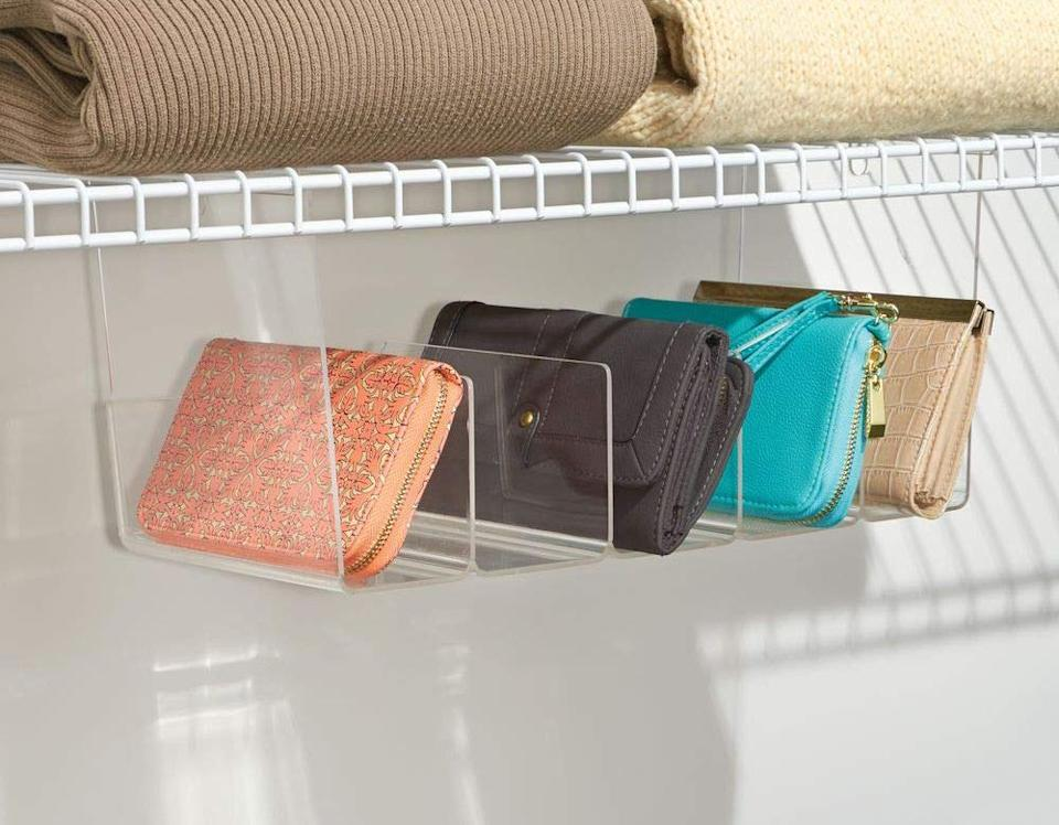 """Attach this under a shelf in your closet, and you'll have an easy place to stash wallets, sunglasses or other small essentials.<br /><br /><strong>Promising review:</strong>""""My wallets, clutches, and change purses are out of the way and organized — not falling all over or off the shelf, I am so glad I bought these! Also, I have a dresser in my closet under the wire racks, and it was unusable space for hanging clothes. These fit perfectly and made great use of the space!"""" —<a href=""""https://amzn.to/3afanec"""" target=""""_blank"""" rel=""""noopener noreferrer"""" data-a-size=""""small"""">Megan</a><a href=""""https://www.amazon.com/gp/customer-reviews/RO7G9IGQS5MVX?tag=bfmal-20&ascsubtag=5902331%2C18%2C37%2Cd%2C0%2C0%2Cgoogle%2C962%3A1%3B901%3A2%3B900%3A2%3B974%3A2%3B975%3A2%3B982%3A1%2C16540674%2C0"""" target=""""_blank"""" rel=""""nofollow noopener noreferrer"""" data-skimlinks-tracking=""""5902331"""" data-vars-affiliate=""""Amazon"""" data-vars-href=""""https://www.amazon.com/gp/customer-reviews/RO7G9IGQS5MVX?tag=bfmal-20&ascsubtag=5902331%2C18%2C37%2Cmobile_web%2C0%2C0%2C16540674"""" data-vars-keywords=""""cleaning,fast fashion"""" data-vars-link-id=""""16540674"""" data-vars-price="""""""" data-vars-product-id=""""15955714"""" data-vars-retailers=""""Amazon""""><br /><br /></a><strong>Get it from Amazon for<a href=""""https://amzn.to/3ahqLLr"""" target=""""_blank"""" rel=""""nofollow noopener noreferrer"""" data-skimlinks-tracking=""""5902331"""" data-vars-affiliate=""""Amazon"""" data-vars-asin=""""B0186FSAIO"""" data-vars-href=""""https://www.amazon.com/dp/B0186FSAIO?tag=bfmal-20&ascsubtag=5902331%2C18%2C37%2Cmobile_web%2C0%2C0%2C16540722"""" data-vars-keywords=""""cleaning,fast fashion"""" data-vars-link-id=""""16540722"""" data-vars-price="""""""" data-vars-product-id=""""18975380"""" data-vars-product-img=""""https://m.media-amazon.com/images/I/41YODYcdw7L.jpg"""" data-vars-product-title=""""mDesign Plastic 5 Compartment Hanging Closet Storage Organizer Tray - Divided Sections for Holding Sunglasses, Wallets, Clutch Purses, Accessories - Hangs Below Shelving - Clear"""" data-vars-retailers=""""Amazon"""">$19.99</a>.</strong>"""