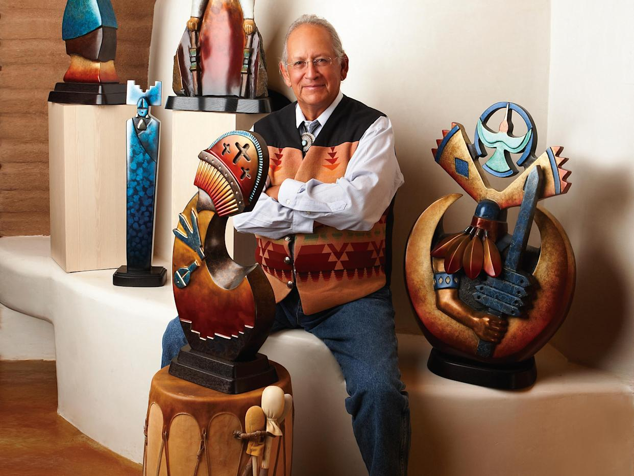 Upton S. Ethelbah Jr. with his artwork. (Photo: Courtesy of Upton S. Ethelbah Jr./greyshoes.com)