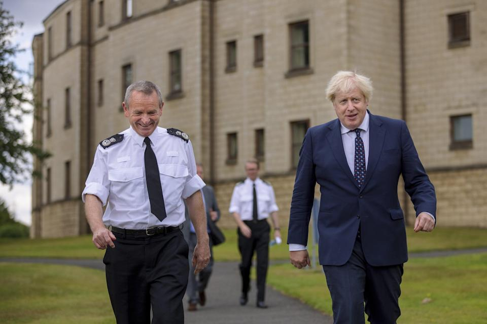 Prime Minister Boris Johnson with Chief Constable Iain Livingstone as he meets officers during a visit to the Scottish Police College at Tulliallan (James Glossop/The Times/PA) (PA Wire)