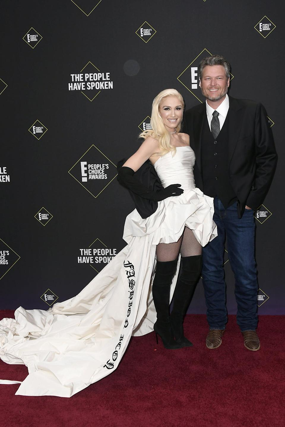 """<p>Gwen wearing <a href=""""https://www.popsugar.com/fashion/gwen-stefani-white-vera-wang-dress-at-peoples-choice-awards-46880476"""" class=""""link rapid-noclick-resp"""" rel=""""nofollow noopener"""" target=""""_blank"""" data-ylk=""""slk:a Vera Wang gown"""">a Vera Wang gown</a> with Casadei over-the-knee boots at the 2019 E! People's Choice Awards.</p>"""