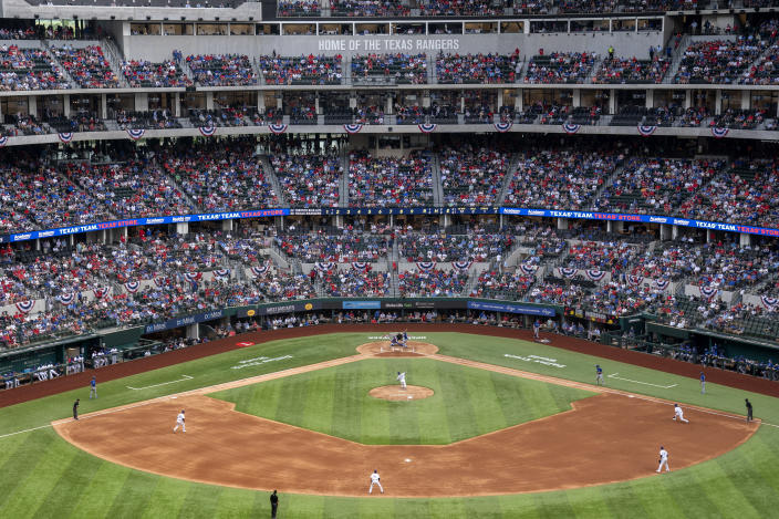 Fans fill the stands at Globe Life Field during the second inning of a baseball game between the Texas Rangers and the Toronto Blue Jays, Monday, April 5, 2021, in Arlington, Texas. The Rangers are set to have the closest thing to a full stadium in pro sports since the coronavirus shutdown more than a year ago. (AP Photo/Jeffrey McWhorter)