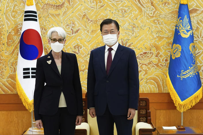 In this photo provided by South Korea Presidential Blue House, South Korean President Moon Jae-in and U.S. Deputy Secretary of State Wendy Sherman, left, pose for photos prior to their meeting at the presidential Blue House in Seoul, South Korea, Thursday, July 22, 2021. Top U.S. and South Korean officials agreed Thursday to try to convince North Korea to return to talks on its nuclear program, which Pyongyang has insisted it won't do in protest of what it calls U.S. hostility. (South Korea Presidential Blue House via AP)