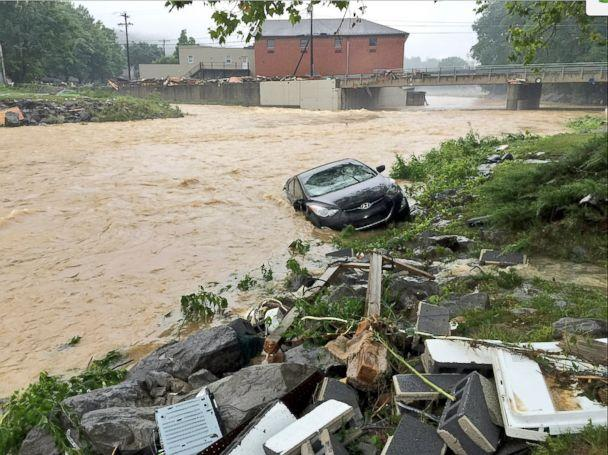 PHOTO: In this photo released by The Weather Channel, a vehicle rests in a stream after heavy rain near White Sulphur Springs, W.Va., June 24, 2016. (Justin Michaels/The Weather Channel via AP)