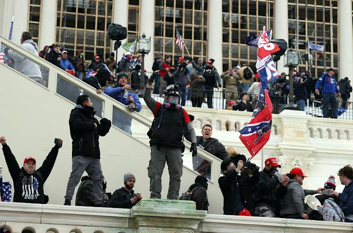 """<span class=""""caption"""">Rioters stormed the U.S. Capitol Jan. 6, but that may not be their last violent move.</span> <span class=""""attribution""""><a class=""""link rapid-noclick-resp"""" href=""""https://www.gettyimages.com/detail/news-photo/protesters-gather-outside-the-u-s-capitol-building-on-news-photo/1294933486"""" rel=""""nofollow noopener"""" target=""""_blank"""" data-ylk=""""slk:Tasos Katopodis/Getty Images"""">Tasos Katopodis/Getty Images</a></span>"""